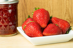 Strawberry jam or jelly with berries. Strawberry jam or jelly with fresh strawberries royalty free stock photos