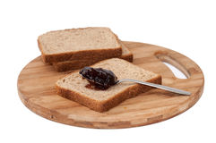 Strawberry jam on the metal spoon over bread Royalty Free Stock Image