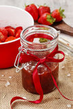 Strawberry jam in preserving glass Stock Image