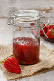Strawberry jam in preserving glass Royalty Free Stock Photography