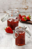 Strawberry jam in preserving glass Stock Images