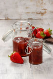 Strawberry jam in preserving glass Stock Photos