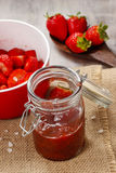 Strawberry jam in preserving glass Stock Photo