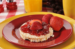 Strawberry jam on a rice cake Royalty Free Stock Photography