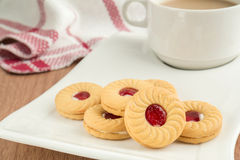 Strawberry jam sandwich biscuits with coffee cup Stock Photos