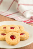 Strawberry jam sandwich biscuits on plate Stock Image