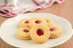 Strawberry jam sandwich biscuits on plate Royalty Free Stock Photo