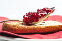 Strawberry jam in a spoon Royalty Free Stock Images