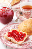 Strawberry jam spread on a slice of bread Stock Photography