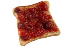 Strawberry jam spread on toast. stock image