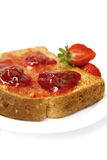 Strawberry jam on toast Stock Photos