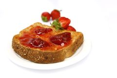 Strawberry jam on toast Stock Images