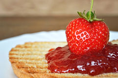 Strawberry jam on toast Royalty Free Stock Photo