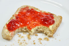 Strawberry Jam on Toast, missing Bite Stock Photo