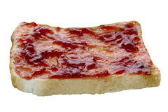 Strawberry Jam on Toast. Strawberry jam on a slice of toast on an an isolated white background with a clipping path Stock Photos