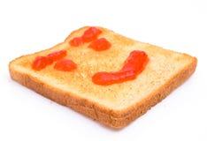 Strawberry jam on toasted bread Stock Photos