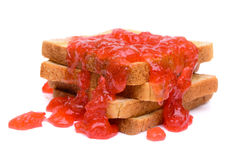 Strawberry jam on toasted bread Stock Image