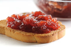 Strawberry jam and toasted slice Stock Images
