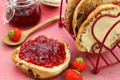 Strawberry jam on toasted teacake Royalty Free Stock Images