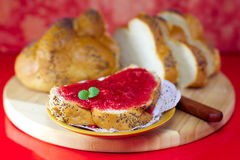 Strawberry jam on a white bread. Decorated on  red background Royalty Free Stock Photo
