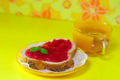 Strawberry jam on a white bread tea cup Stock Image