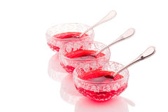 Strawberry jelly desserts in nice glass bowls. In white background stock photography