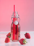 Strawberry juice in a bottle Royalty Free Stock Photos