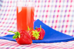 Strawberry juice checkered napkin Royalty Free Stock Photos