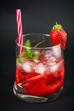 Strawberry juice in a crooked drinking glass Royalty Free Stock Images
