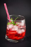 Strawberry juice in a crooked drinking glass Royalty Free Stock Photo
