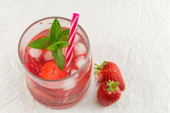 Strawberry juice in a crooked drinking glass Stock Photo