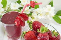 Strawberry juice and fresh strawberries served on the plate Royalty Free Stock Photography