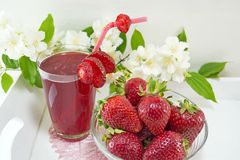 Strawberry juice and fresh strawberries served on the plate Stock Photography