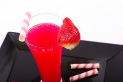 Strawberry juice in glass top view. Strawberry juice in glass with candies over white background Stock Image