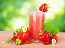 Strawberry juice green background Stock Photography