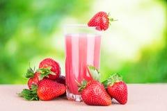 Strawberry juice green background Stock Image