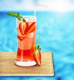 Strawberry juice on the poolside Stock Photo