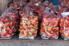 Strawberry juicy fruit in plastic bag Royalty Free Stock Photos