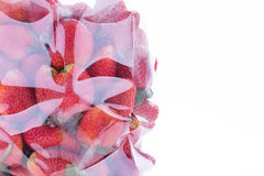 Strawberry juicy fruit in plastic bag packaging Stock Images