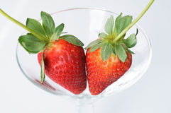 Strawberry kisses. Two strawberries kissing Royalty Free Stock Photography