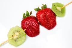 Strawberry and kiwi Stock Images