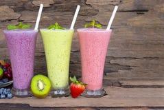 Strawberry kiwi and blueberry  smoothies colorful fruit juice milkshake. stock photo