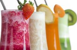 Strawberry ,kiwi, carrot and banana smoothie on white background royalty free stock photo
