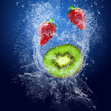 Strawberry and kiwi under water Stock Images