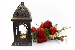 Strawberry. Lantern, candle and chaff Royalty Free Stock Photo