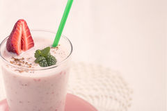 Strawberry lassi at left side Royalty Free Stock Photos