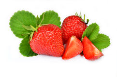 Strawberry with leaves isolated on a white background. Strawberry with leaves isolated on a white royalty free stock image