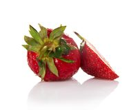 Strawberry with leaves and a slice Stock Photos