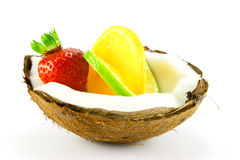 Strawberry,Lemon and Lime in a Coconut. Single red strawberry,lemon and lime slice in half a coconut with a white background Stock Images