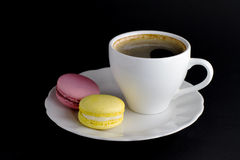 Strawberry and lemon macaroon and a cup of coffee Stock Photos